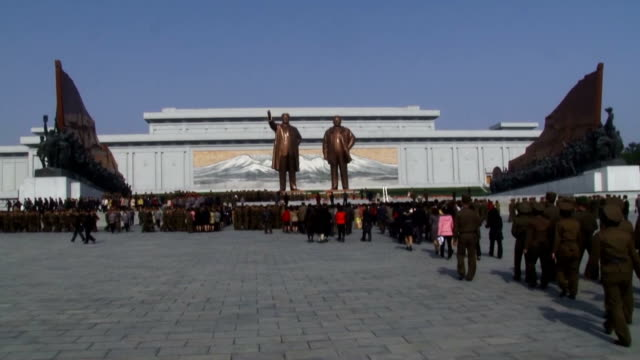 north koreans offer flowers at mansudae hill where bronze statues of former leaders kim il sung and kim jong il stand in pyongyang on april 15 to... - joint chiefs of staff stock videos and b-roll footage