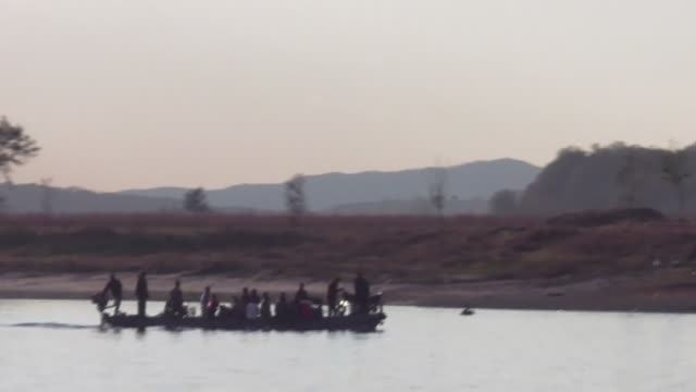 north koreans ride a ferry crossing the yalu river near a border fence. - ferry ride stock videos & royalty-free footage