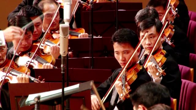 north korea's state symphony orchestra performed beethoven's ninth symphony under the baton of celebrated japanese conductor michiyoshi inoue at the... - classical stock videos & royalty-free footage