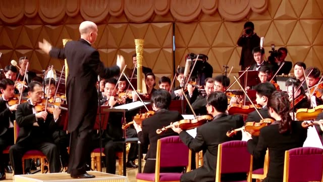 vídeos de stock, filmes e b-roll de north korea's state symphony orchestra performed beethoven's ninth symphony under the baton of celebrated japanese conductor michiyoshi inoue at the... - orquestra