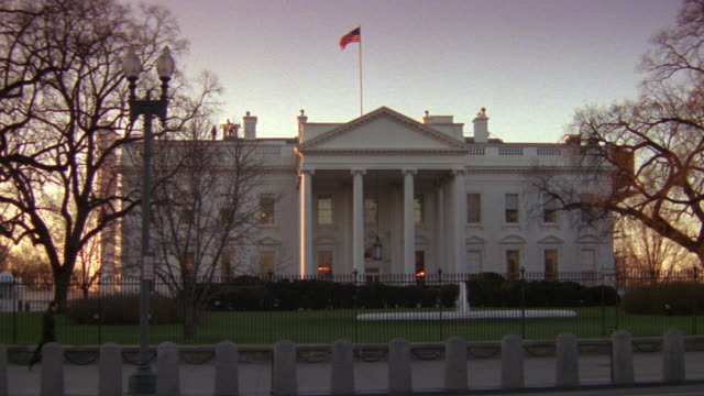 ms north lawn of white house with fence and barriers at late evening / washington d.c., united states - white house washington dc stock videos & royalty-free footage