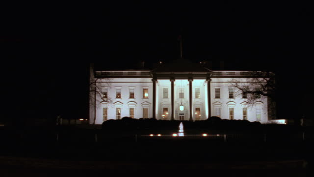 ms north lawn of white house with fence and over barricades / washington d.c., united states - white house washington dc stock videos & royalty-free footage