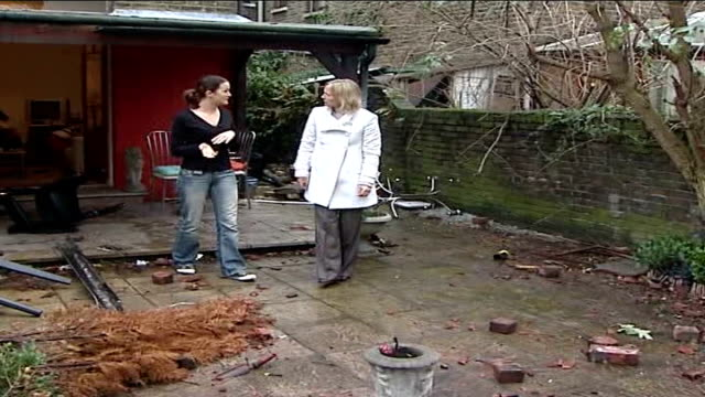tornado aftermath jade francis along with traquair into wreckage of back garden jade francis interview sot pan rubble on ground talks about tornado... - トラクエア点の映像素材/bロール