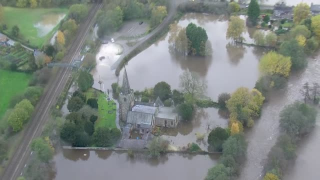 aerial views of flooding in the north midlands england north midlands views / aerials various of flooded countryside and fields / church surrounded... - river stock videos & royalty-free footage