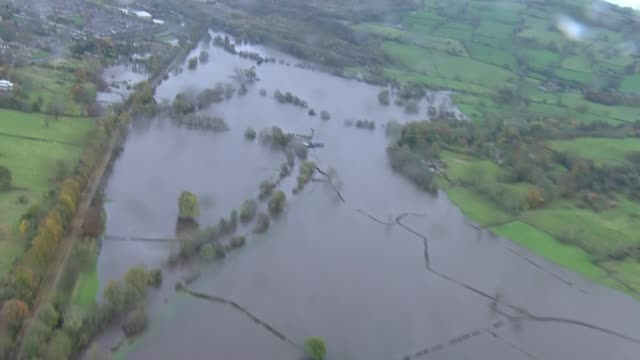 aerial views of flooding in the north midlands england north midlands views / aerials people wading through water / various of flooded fields and... - field stock videos & royalty-free footage