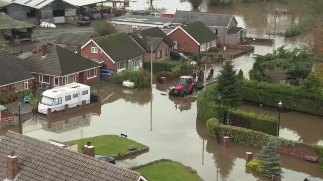 residents voice anger about flood defences as some homes still under water england south yorkshire fishlake ext residents sit in dinghy as pulled... - yorkshire england stock videos & royalty-free footage