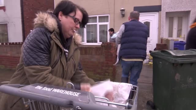 residents voice anger about flood defences as some homes still under water england south yorkshire doncaster bentley ext gv locals lifting sandbags... - yorkshire england stock videos & royalty-free footage