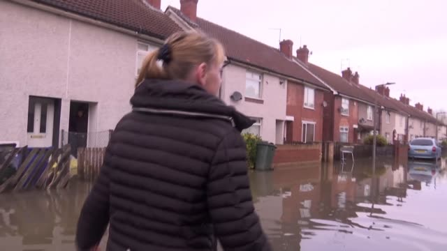 residents voice anger about flood defences as some homes still under water england south yorkshire doncaster bentley ext various shots lesley kelly... - yorkshire england stock videos & royalty-free footage