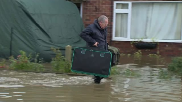 north of england flooding: residents warned more rain is forecast; england: south yorkshire: fishlake: ext general views of local residents removing... - shower stock videos & royalty-free footage