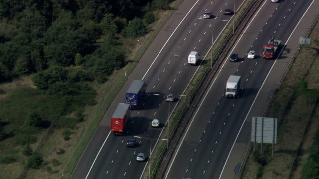 m25 north of thames estuary  - aerial view - england, essex, united kingdom - motorway stock videos & royalty-free footage