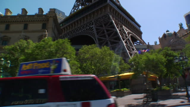 north on las vegas boulevard passing paris hotel & casino, approching bally's. the strip - bally's las vegas stock videos & royalty-free footage