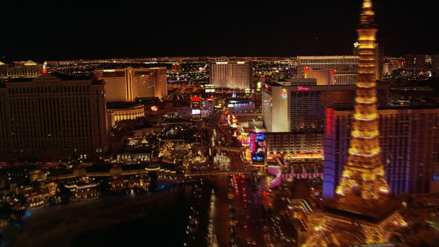 north over the strip at high speed - the strip las vegas stock-videos und b-roll-filmmaterial