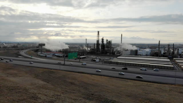 north salt lake oil refinery near busy interstate 15 traffic - air pollution stock videos & royalty-free footage