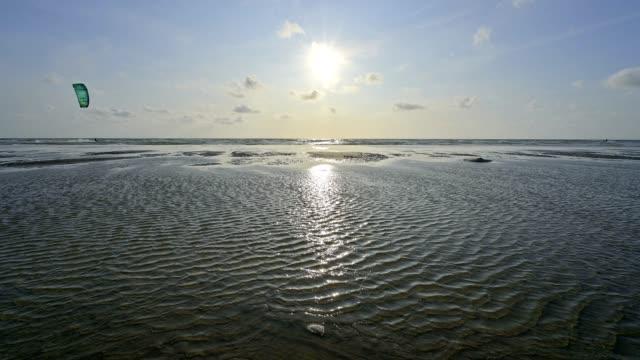 north sea beach with kitesurfers in summer, romo, röm, tonder kommune, syddanmark, southern denmark, denmark - kommune stock-videos und b-roll-filmmaterial