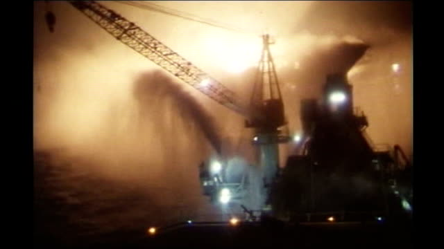 north sea helicopter crash: investigation begins; tx 7.7.1988 north sea: ext / night / at sea air views burning piper alpha oil rig - alpha cell stock videos & royalty-free footage