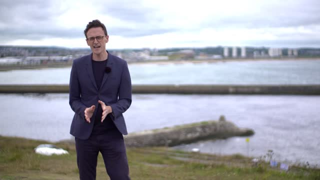 north sea oil company chief exec claims climate emergency is 'fake'; scotland: aberdeen: ext reporter to camera sot. - business stock videos & royalty-free footage