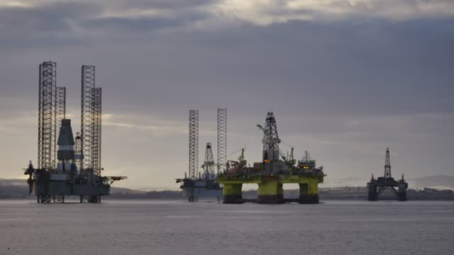 north sea oil rigs in the cromarty firth of easter ross scotland uk the oil platforms are brought into the cromarty firth for refitting and... - piattaforma offshore video stock e b–roll