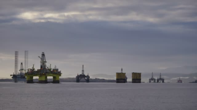 north sea oil rigs in the cromarty firth of easter ross scotland uk the oil platforms are brought into the cromarty firth for refitting and... - ross sea stock videos & royalty-free footage
