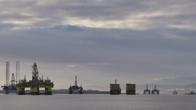 north sea oil rigs in the cromarty firth of easter ross scotland uk the oil platforms are brought into the cromarty firth for refitting and... - winter stock videos & royalty-free footage