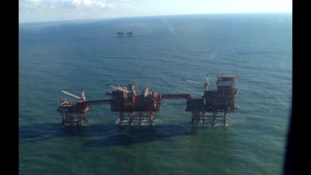 north sea oil tax rise criticised by oil executive; tx 6.11.2006 north sea: 15 miles off yorkshire coast: ext aerials centrica rough gas storage... - north sea stock videos & royalty-free footage