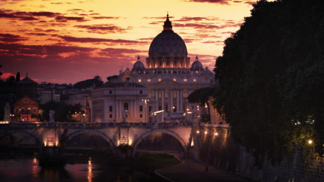 North side of the Ponte Sant'Angelo and St. Peter's Basilica at sunset