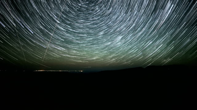North Star over Kiger Gorge on Steens Mountain with City of Burns in Distance Abstract Star Trails Night Time Lapse