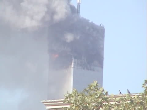 north tower burning, south tower has collapsed. footage taken from a rooftop in the lower east side, new york city. - tower stock videos & royalty-free footage