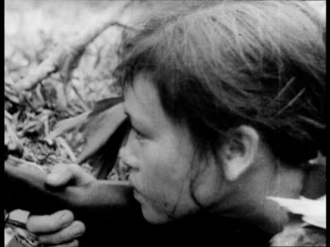north vietnamese propaganda account of the us military's atrocities committed against the civilians of vietnam - vietnamkrieg stock-videos und b-roll-filmmaterial