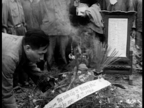 north vietnamese propaganda account of the us military's atrocities committed against the civilians of vietnam - guerra del vietnam video stock e b–roll