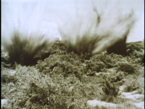 a north vietnamese soldier gestures and shouts for a bazooka to be fired during a battle of the vietnam war - ベトコン点の映像素材/bロール