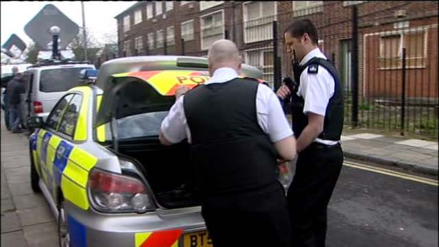 police expected to apply for further extensions to hold suspects 1042009 england liverpool ext police officers carrying bag of evidence to police car... - merseyside stock videos and b-roll footage