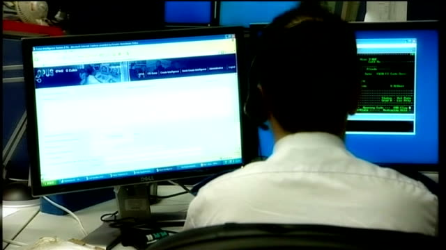 north yorkshire chief constable admits to 'disreputable conduct' lib int male control room operator working at computer in police call centre person... - control room stock videos & royalty-free footage
