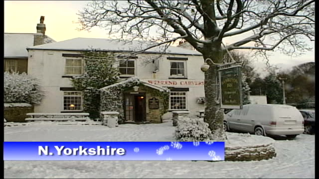 north yorkshire ext snow covered pub bv car reversing towards along slush and snow ms transit van away following digger over snow covered country... - slush stock videos and b-roll footage
