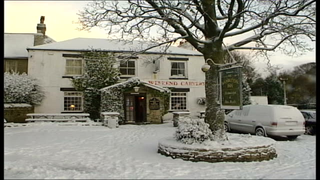 north yorkshire: ext snow covered pub transit van away following digger over snow covered country lane - itv late evening bulletin点の映像素材/bロール