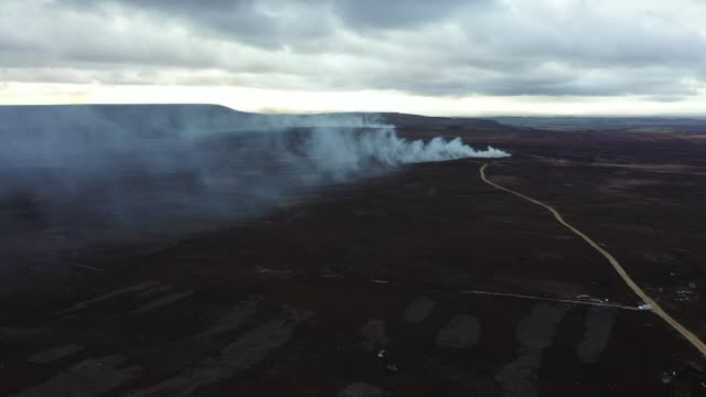 north yorkshire moors heather burning - drone footage; england: yorkshire: north york moors: ext air views /aerials / drone footage controlled... - ontario canada stock videos & royalty-free footage