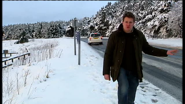 pickering wide view snowcovered north york moors snowy fields reporter to camera icicles car along snowy rural road town houses with snow falling... - north york stock videos & royalty-free footage