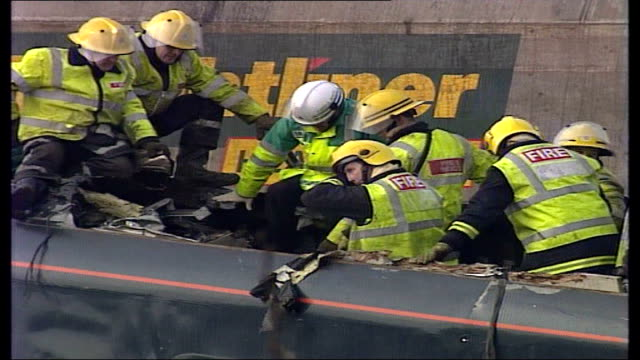Selby train crash general views of site and emergency workers ENGLAND North Yorkshire Near Selby Great Heck EXT Group of firemen cutting into...