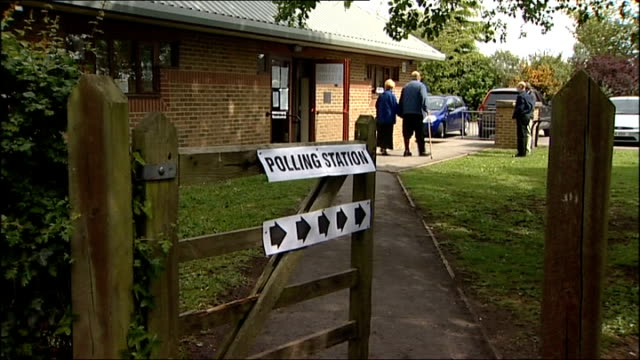 north yorkshire thirsk and malton constituency ext 'polling station' sign on wall pull out various of people arriving at polling stations - politische gruppe stock-videos und b-roll-filmmaterial