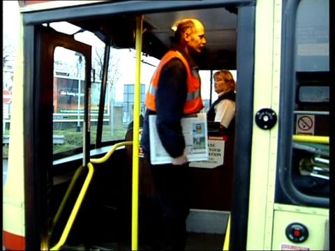 northampton station / passengers on bus england horthamptonshire northampton northampton station / train information on tv monitor / gv bus waiting /... - northampton stock-videos und b-roll-filmmaterial
