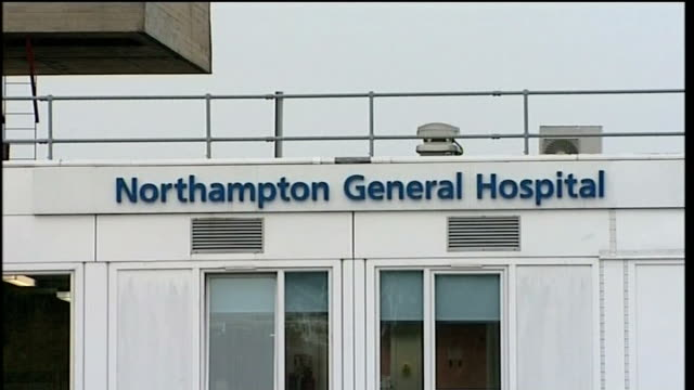 general views northampton general hospital and police car along at hospital - northampton stock-videos und b-roll-filmmaterial