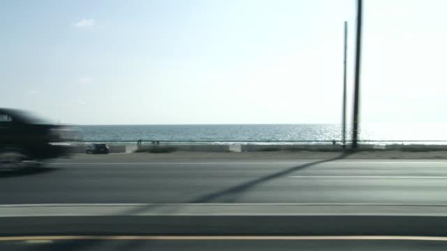 WS POV Northbound on PCH along Zuma beach / Malibu, California, USA