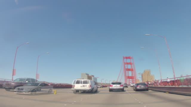 northbound on u.s. highway 101 on a sunny day. time lapse shows freeway, golden gate bridge, city of san francisco, lombard street. - lombard street san francisco stock videos & royalty-free footage