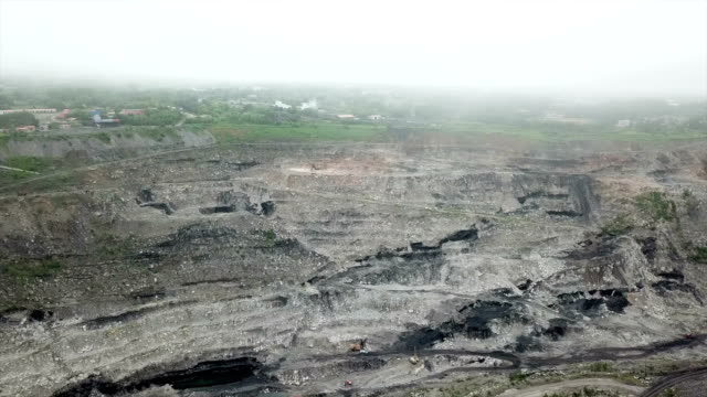 northeast china, a coal mine to be depleted.aerial view of opencast mining quarry - miniera di carbone video stock e b–roll