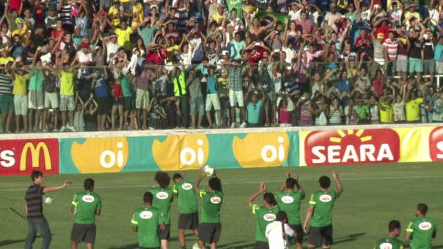 northeastern brazil is celebrating the first visit by the national team in 11 years voiced selecao fever hits the brazilian town on june 19 2013 in... - northeastern brazil stock videos and b-roll footage