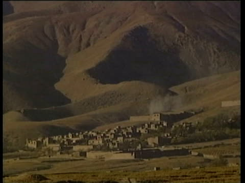 Northern Alliance advance and firing on road to Kabul tanks explosions artillery attacks Taliban fires on Northern Alliance on November 12 2001 in...