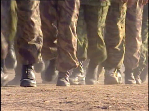 Northern Alliance soldiers marching in camp War in Afghanistan 2001