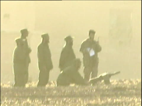vidéos et rushes de northern alliance soldiers practicing gunfire and tank manoeuvres war in afghanistan 2001 - guerre d'afghanistan : de 2001 à nos jours