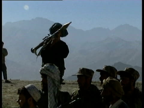 northern alliance taking up positions outside kabul against the taliban refugees standing on roadside cu mother holding child / tanks northern... - afghanistan stock videos & royalty-free footage