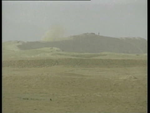 Northern Alliance tanks and mortar firing at Taliban positions forward trenches fighter sets off mortars as he chants Allah'u Akbar Northern Alliance...