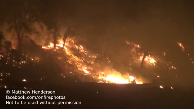 northern california's massive rocky fire spread to 65,000 acres on tuesday, august 4, https://twitter.com/calfire_pio/status/628606472759345152 cal... - https stock videos & royalty-free footage